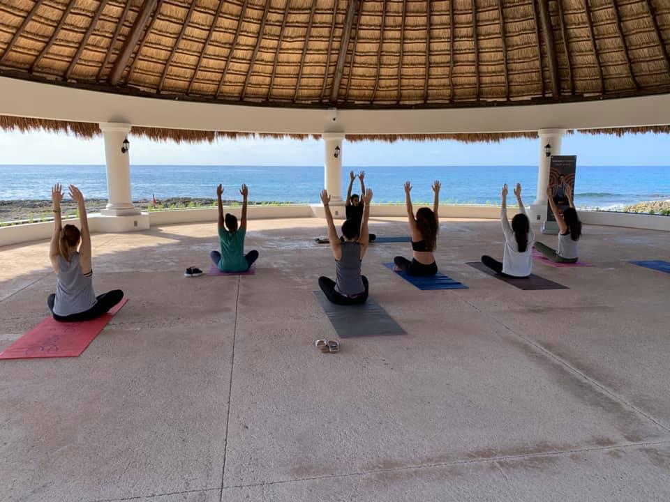 Hands up for early morning yoga at Hard Rock Riviera Maya!