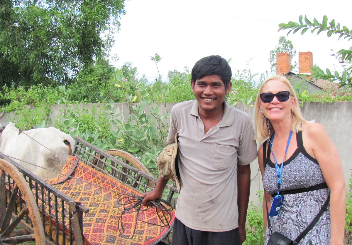 Meeting the locals in Cambodia (photo courtesy of Vicky Lubyk).