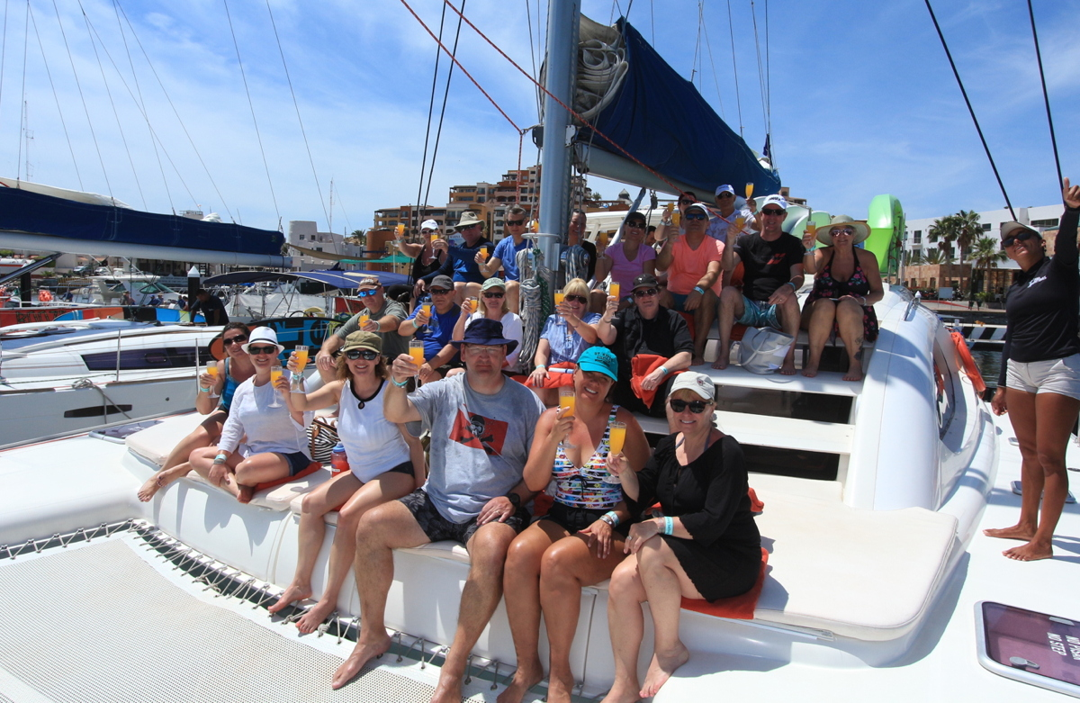 CHEERS! Retreat attendees share a toast on board a yacht in Cabo San Lucas. Photo courtesy of TravelOnly.
