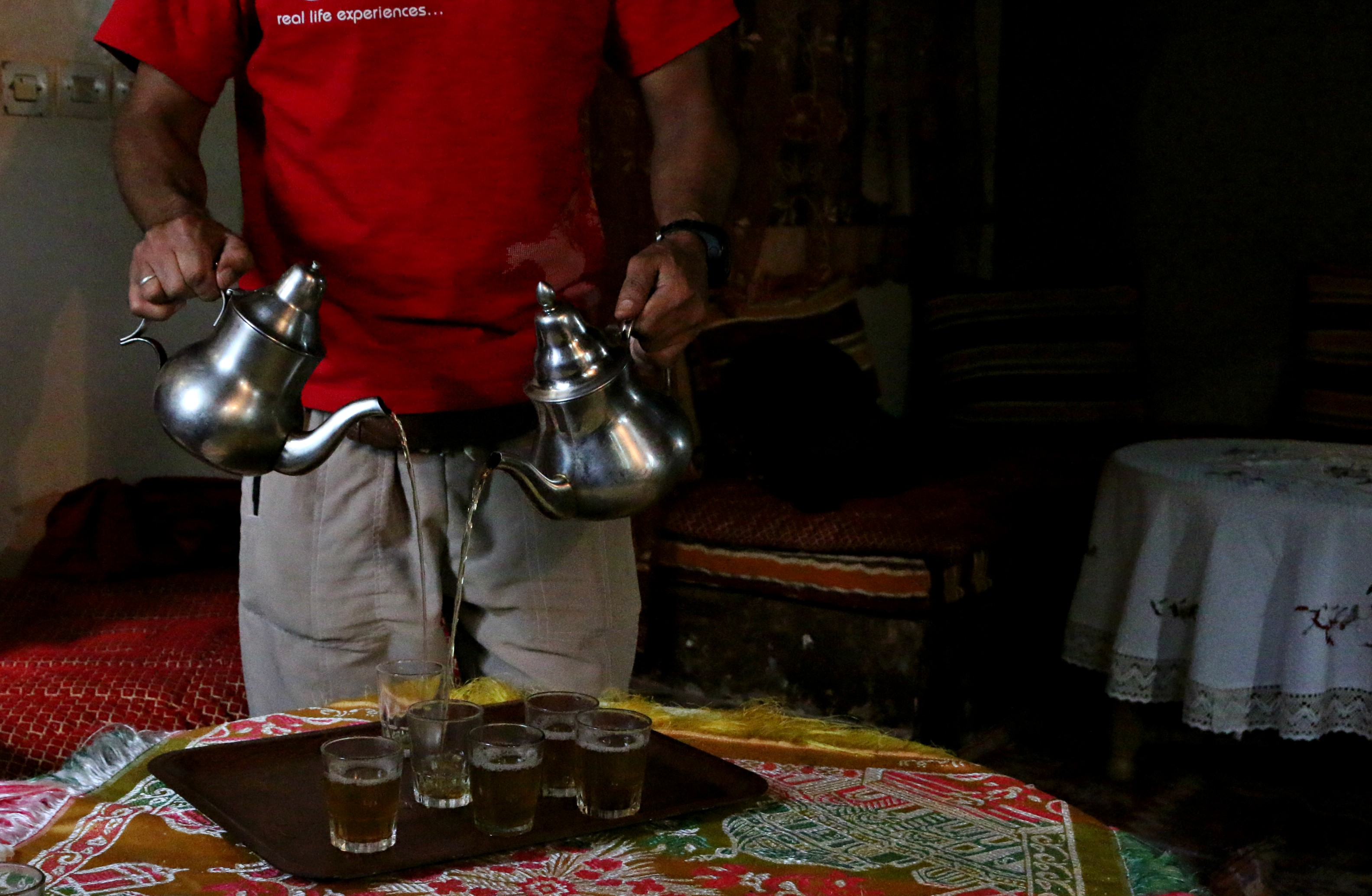 Lahcen Hamyouy, local guide, expertly pours mint tea at lunch.
