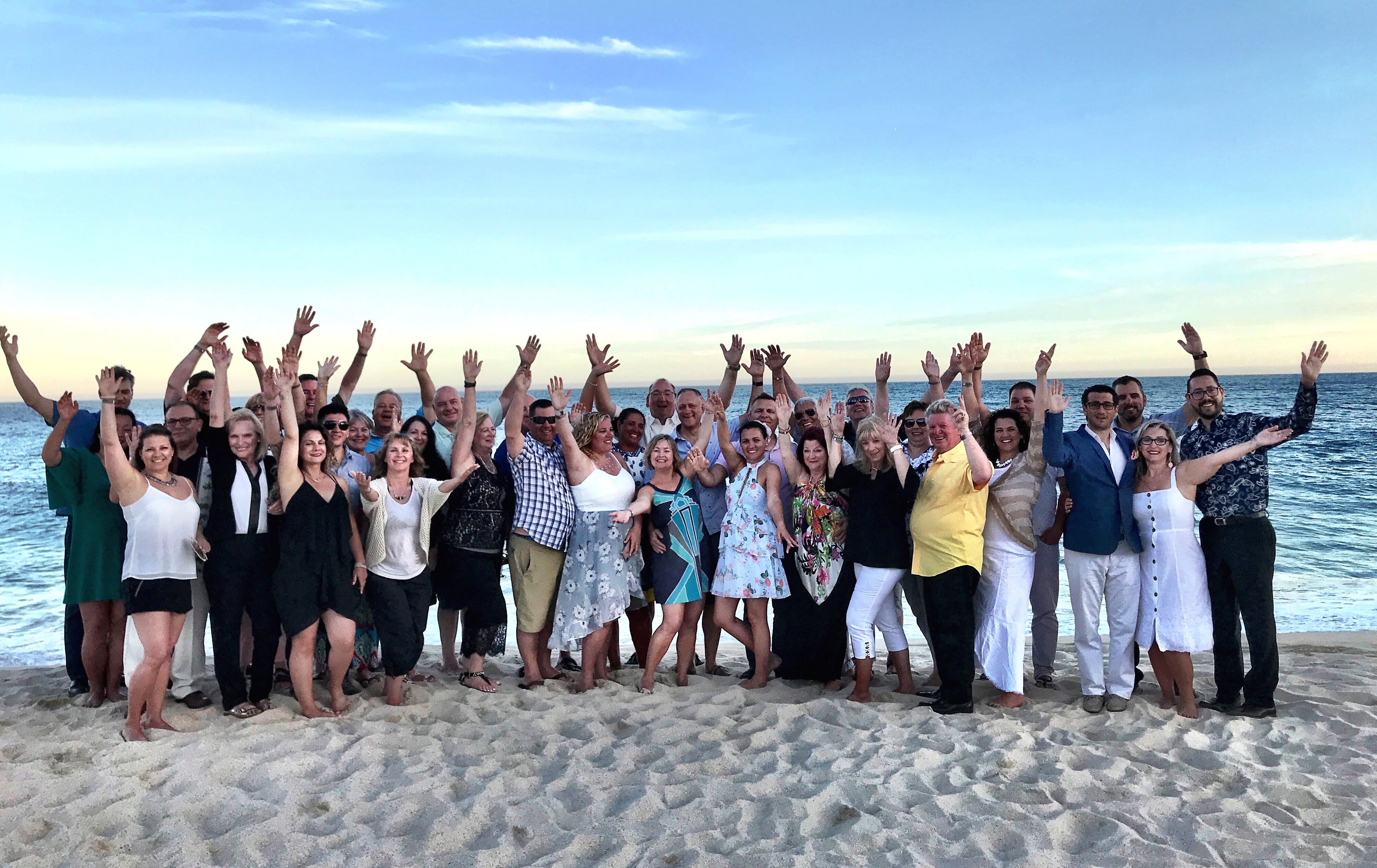 GROUP PHOTO. TravelOnly's top producers and guests pose for a photo on the beachfront of Le Blanc Spa Resort in Los Cabos, Mexico.