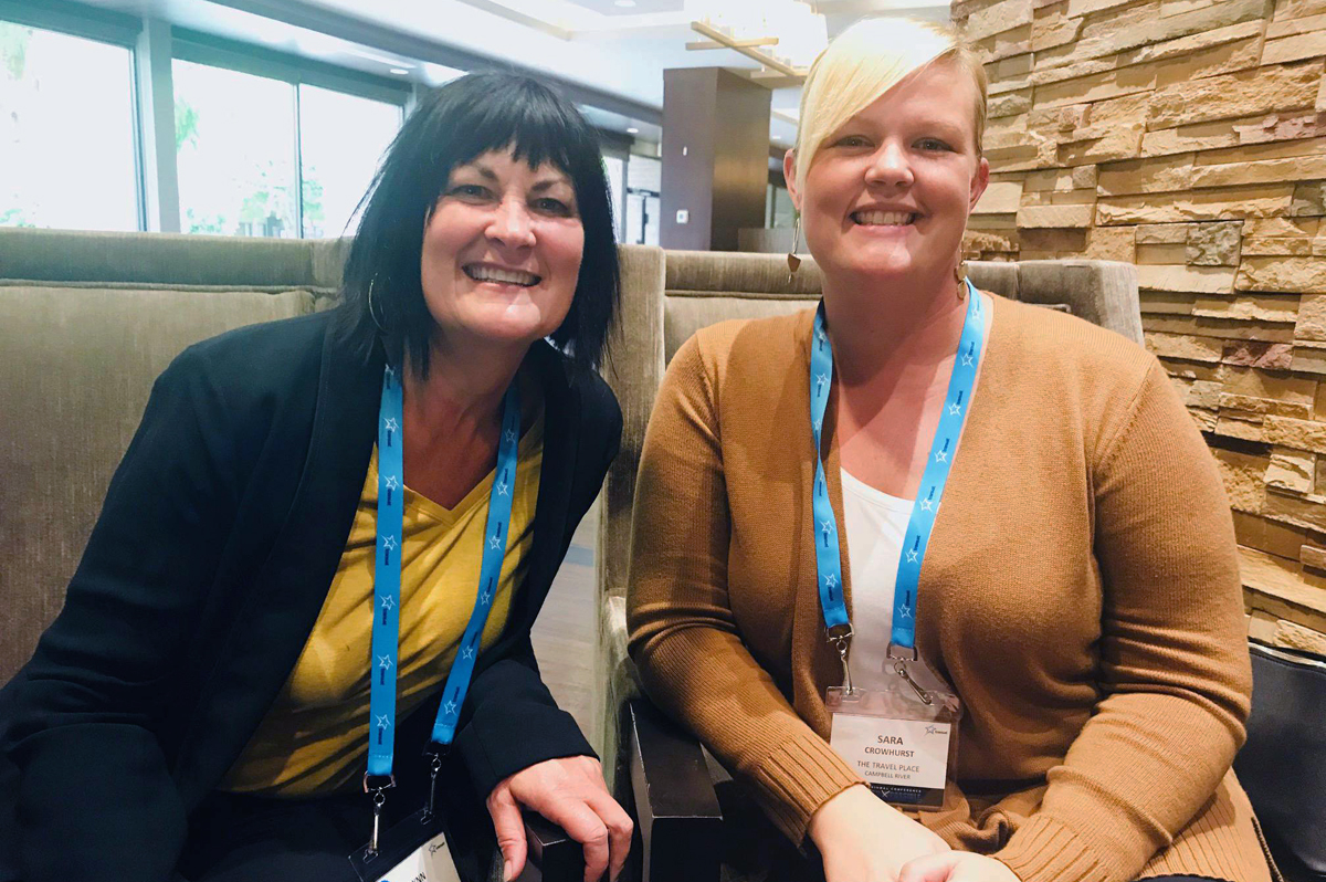 Co-workers Lynn Hipwell (left) and Sara Crowhurst are travel consultants at The Travel Place in Campbell River, BC.