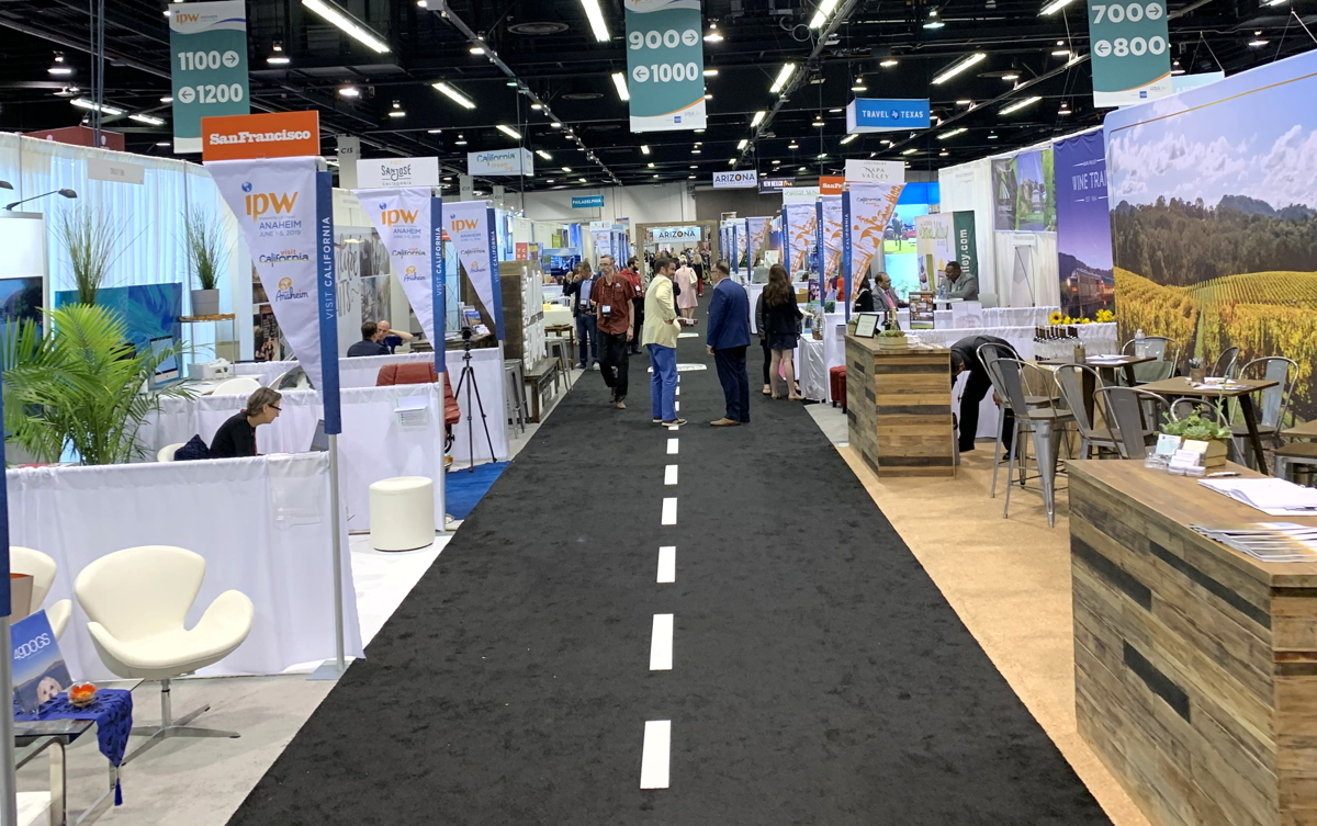 OPEN FOR BUSINESS. Into the IPW Marketplace, a sprawling space of exhibitors representing more than a thousand U.S. destinations and attractions.