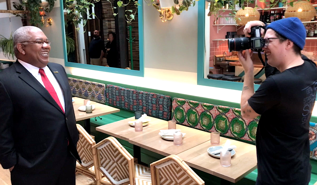 WORK IT. Photographer Geoff Fitzgerald (right) photographs Gary Sadler at Chubby's Jamaican Kitchen in Toronto.