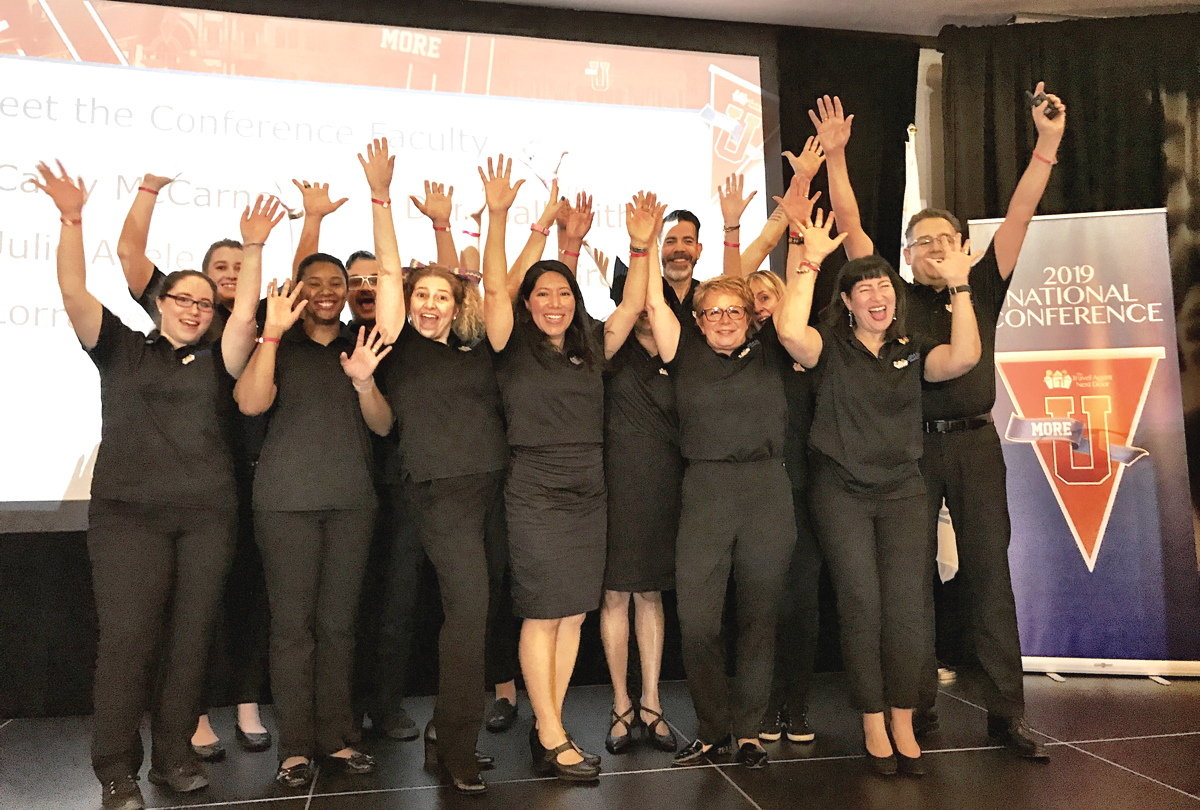 HANDS UP! The TTAND team welcomed conference attendees.Monday morning.