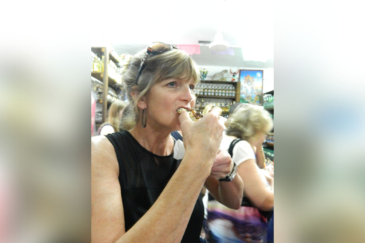 Lynne trying crickets. (Photo courtesy of Lynne White)