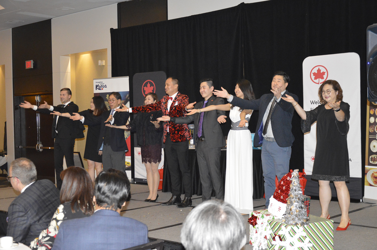 Members of Air Canada's Asia sales team get into the holiday spirit with a dance for the audience