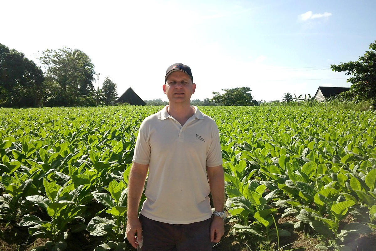 Eloy stands in a tobacco field near his family's house, in Viñales, Pinar del Río. (supplied photo)